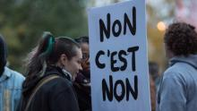 "A demonstrator holds a sign that reads ""No means no"" during a march against rape culture in Montreal Wednesday evening. The provincial government will unveil its five-year strategy to prevent and counter sexual violence today. (Paul Chiasson/Canadian Press)"