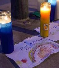 prayer candles and drawing of rainbow