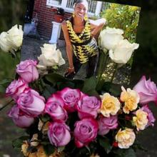 photo of Charleena on top of bouquet of roses