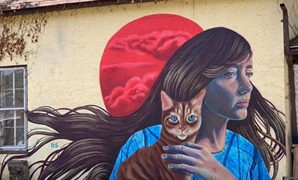 mural of a woman and a cat