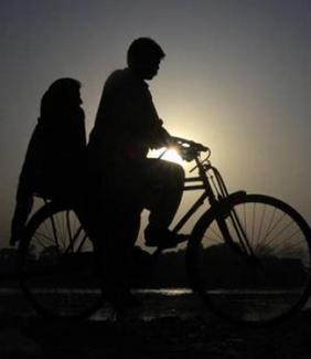 two people on bicycle