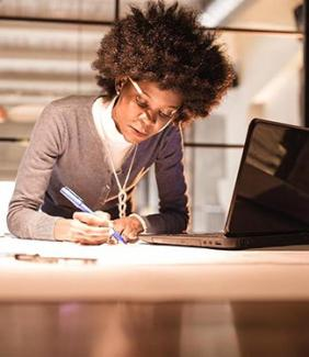 women of color working at a desk