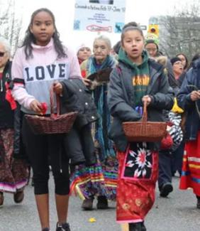 young women lead the annual memorial march