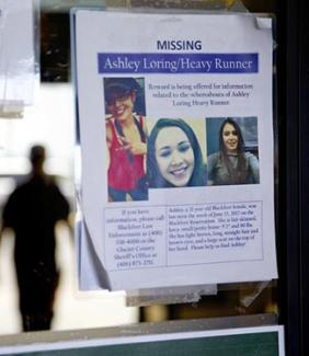 A missing poster for Ashley HeavyRunner Loring is posted to the entrance of a grocery store on the Blackfeet Indian Reservation