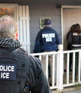 ICE officials outside a house