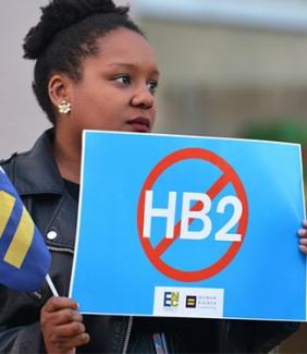 Cassandra Thomas of Human Rights Campaign holds a sign advocating the repeal of HB2 on Dec. 7 in Charlotte.