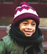 child wearing a winter hat and coat