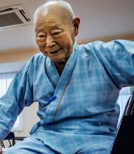 An elderly patient receives rehabilitation care in Japan