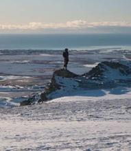 Woman overlooking Nome from Anvil Mountain