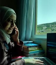 UN Women field assistant Amal Al Mahayrah makes daily support calls