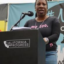 Tarana Burke speaking at a podium