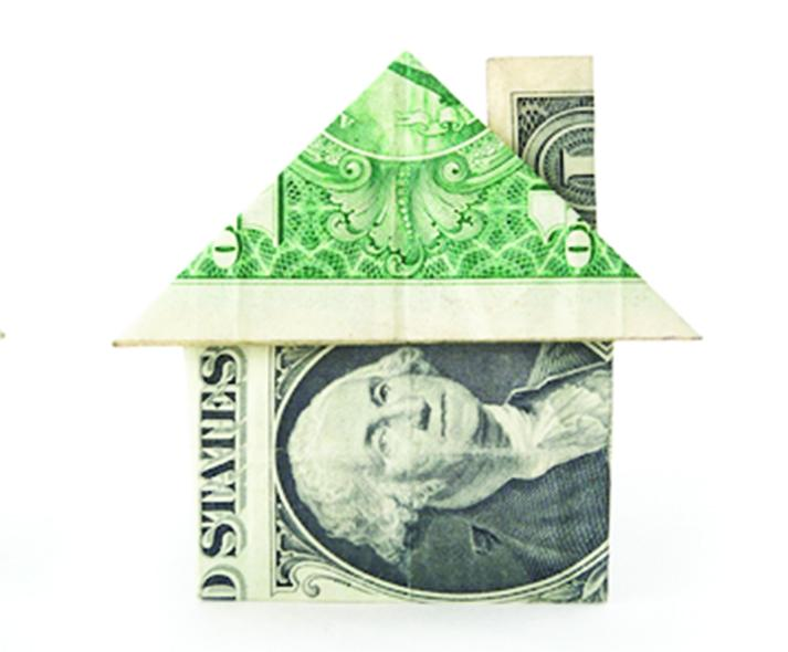 dollar bill folded into a house