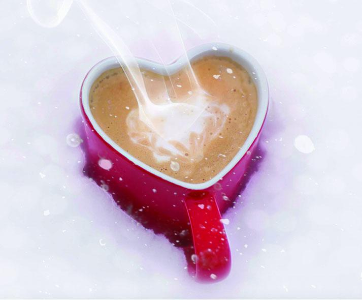 heart shaped mug of hot chocolate